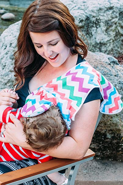 Image: Milkmade Nursing Cover | Peek-a-boo flap makes it easy for mom and baby to see each other while nursing, which fosters a strong bond. Mom chooses if baby's face is shaded