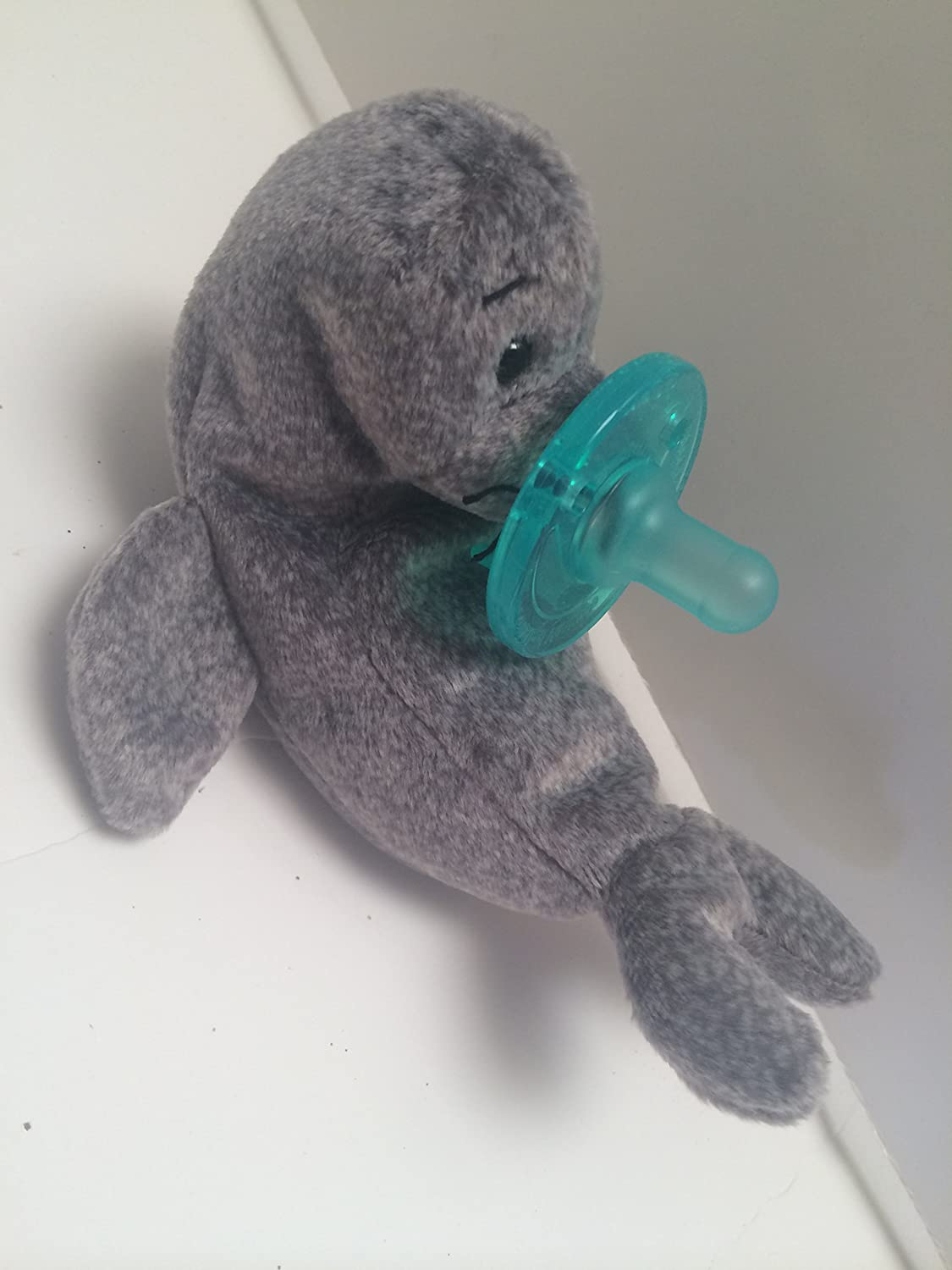 Amazon.com: Peluche Animal paciifer Buddy (Sello): Baby