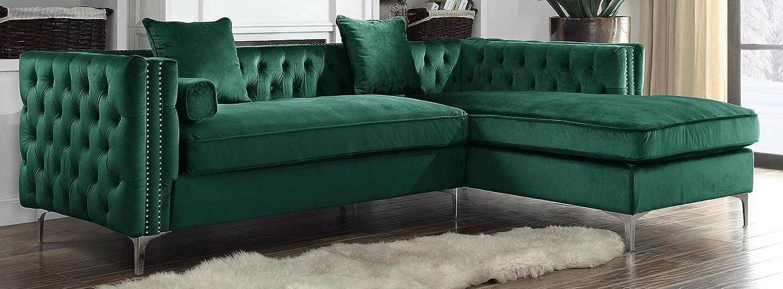 A green velvet L shape corner sofa