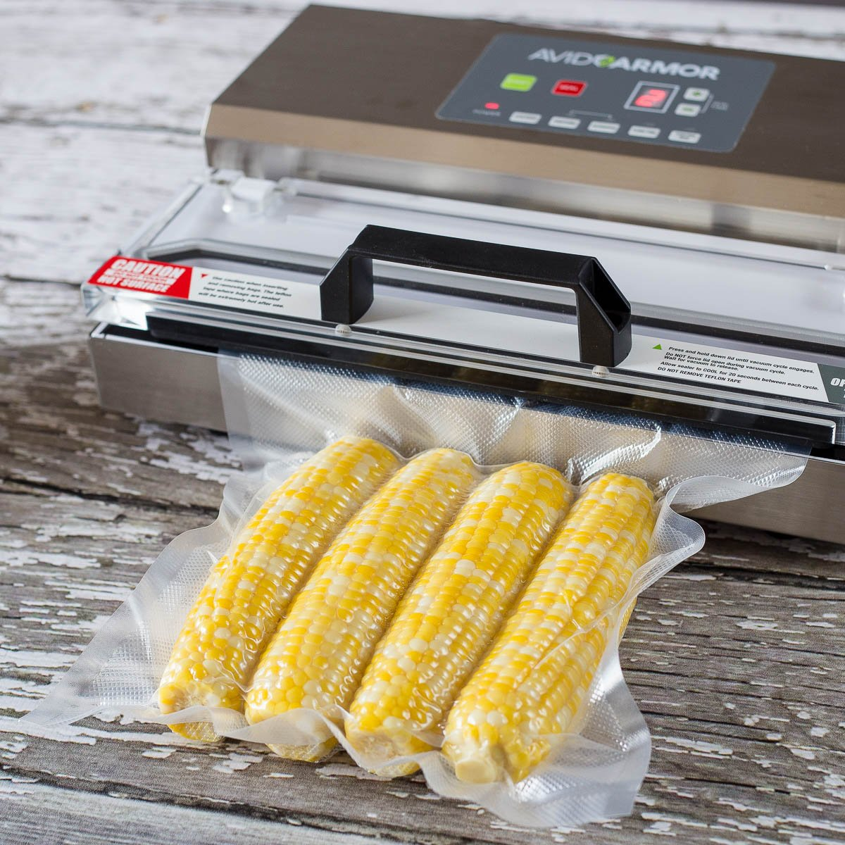 Avid Armor Vacuum Sealer Machine - A100 Stainless Construction, Clear Lid, Commercial Double Piston Pump Heavy Duty 12'' Wide Seal Bar Built in Cooling Fan Includes 30 Pre-cut Bags and Accessory Hose by Avid Armor (Image #7)