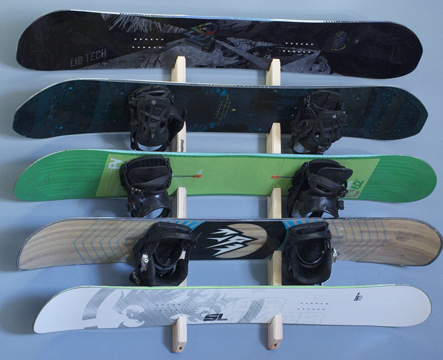 Wooden wall mounted rack for all types of skateboards and snowboards