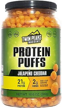 Twin Peaks es bajo en calorías, Protein Puffs es apto para alérgicos, Ajo Parmesano (300g, 21g de proteína, 2g de carbohidratos, 130 calorías)