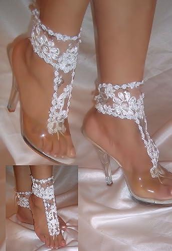 90fa6e6a56bb Amazon.com  White Flower Barefoot Sandals