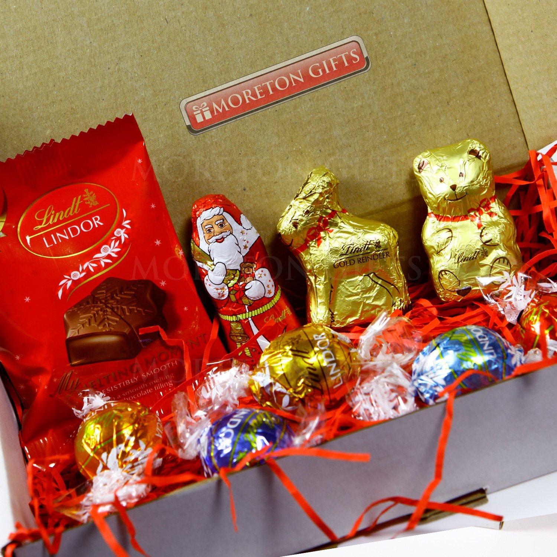 the lindt christmas treat box santa reindeer gold bear melting