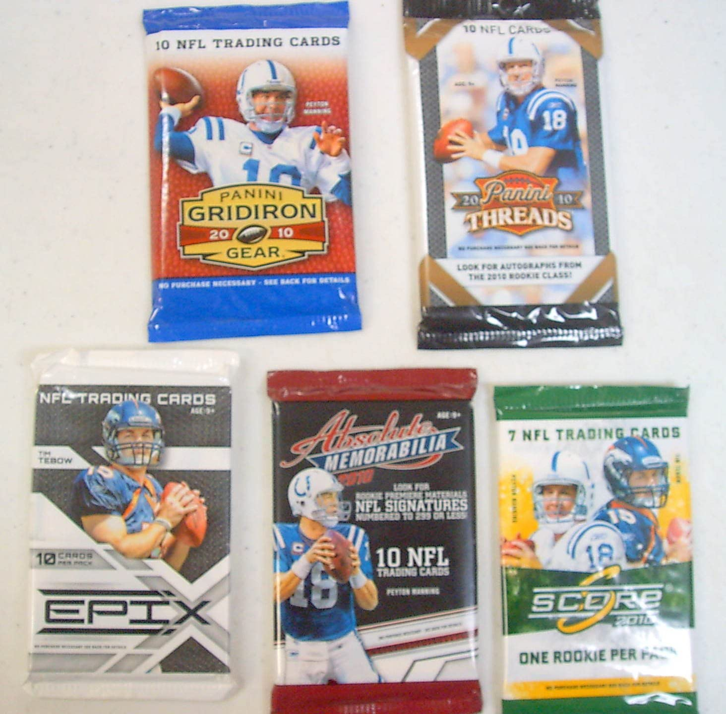 B0068S7T2A 5 (Five) 2010 NFL Football PACKS. EPIX, Absolute MEMORABILIA, Panini Threads, Gridiron Gear and Score. Look for rookie cards of Tim Tebow, Sam Bradford, Ryan Mathews, Dez Bryant, Colt McCoy, Jahvid Best, Clausen, Suh and many more 81EKubNcViL