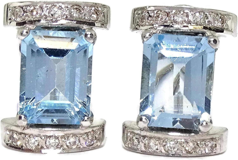 Pendientes con 20 diamantes talla brillante de 0.18cts y 2 topacios azules de 7x9 con Cierre omega Peso; 8.10gr de oro de 1ª Ley
