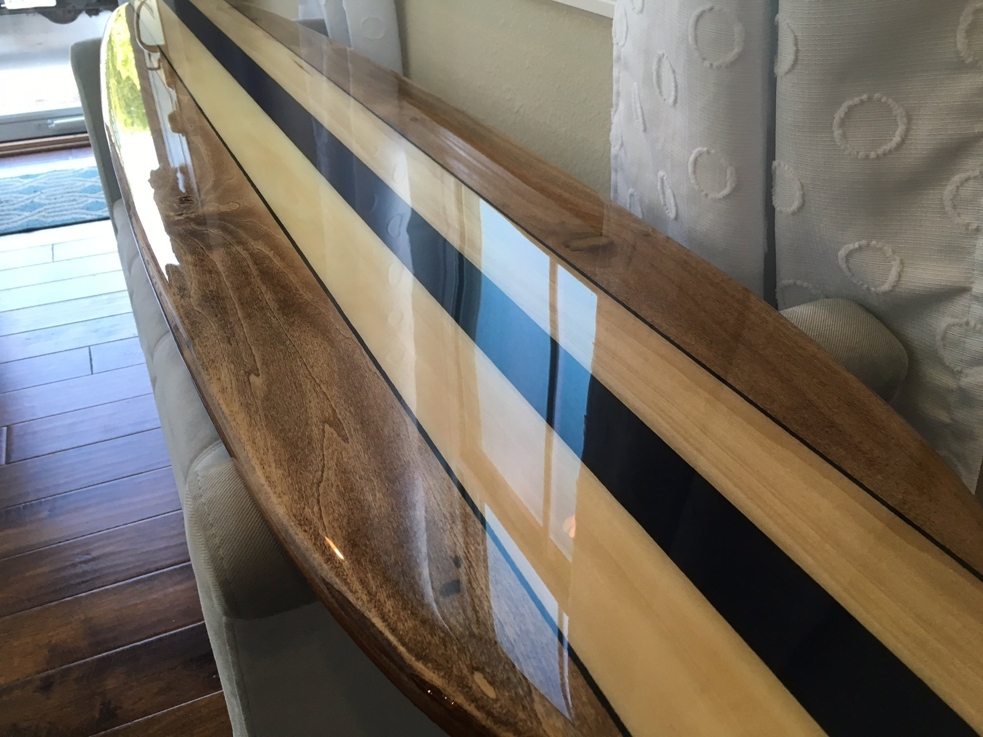 Six foot surfboard wall hanging. Poplar surfboard wall art with navy blue center stringer.
