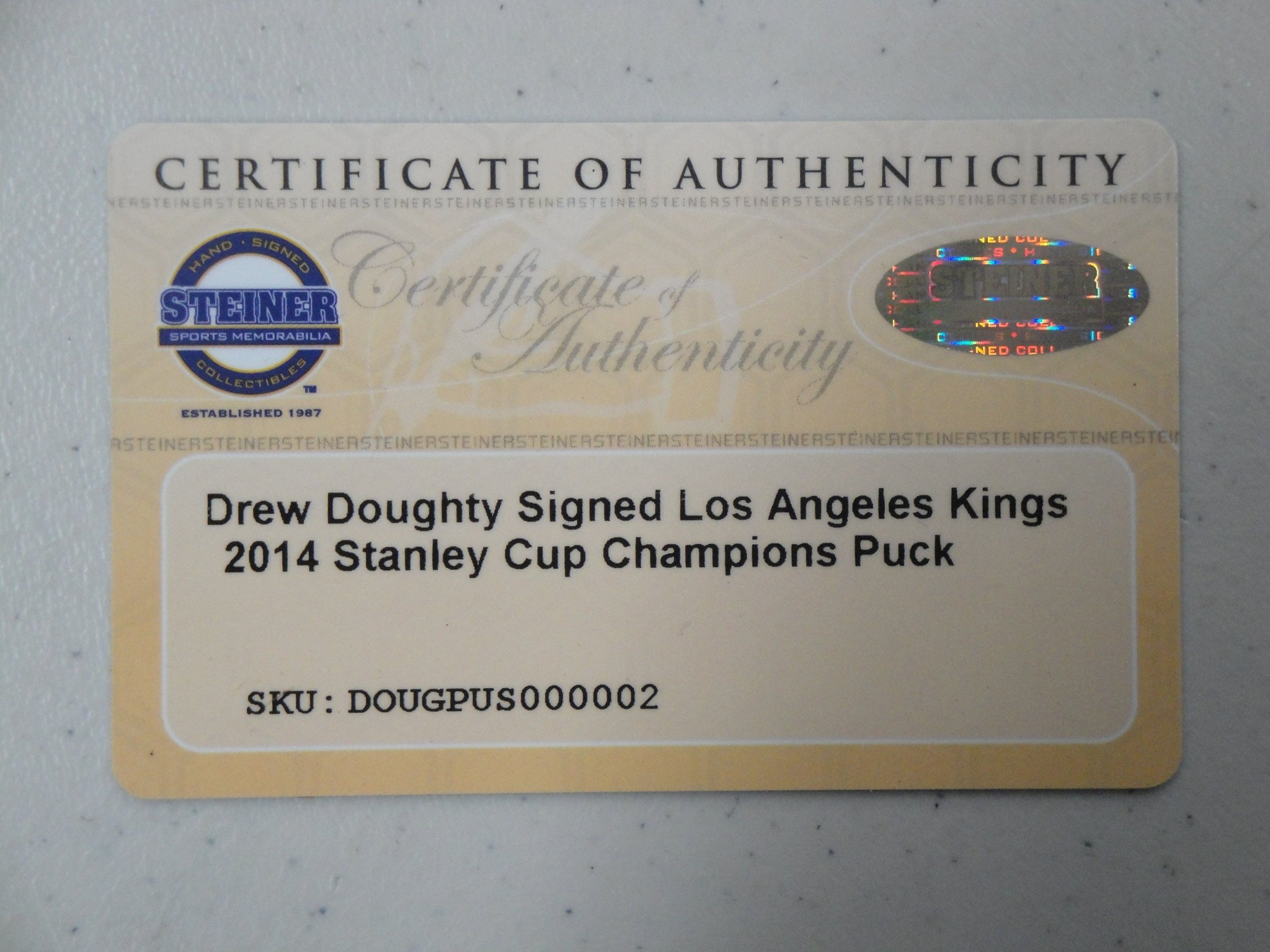 Drew Doughty Signed Autographed LA Kings Puck 2014 Stanley Cup Champions Steiner