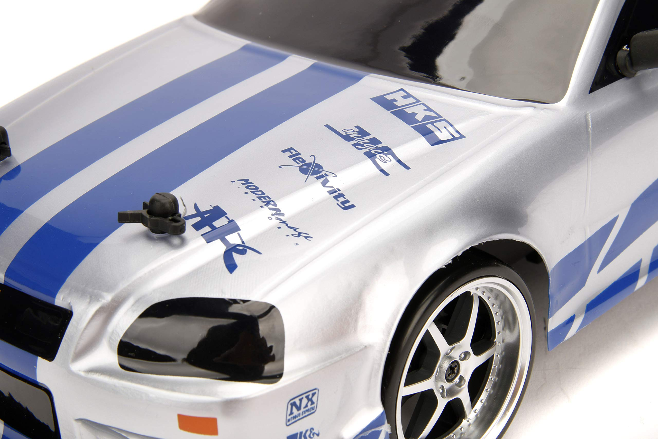 Jada 99701 Toys Fast & Furious Brian's Nissan Skyline GT-R (BN34) Drift Power Slide RC Radio Remote Control Toy Race Car with Extra Tires, 1:10 Scale, Silver/Blue by Jada (Image #4)