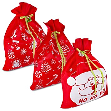 3 giant christmas gift bags 36 x 44 reusable made of durable fabric with