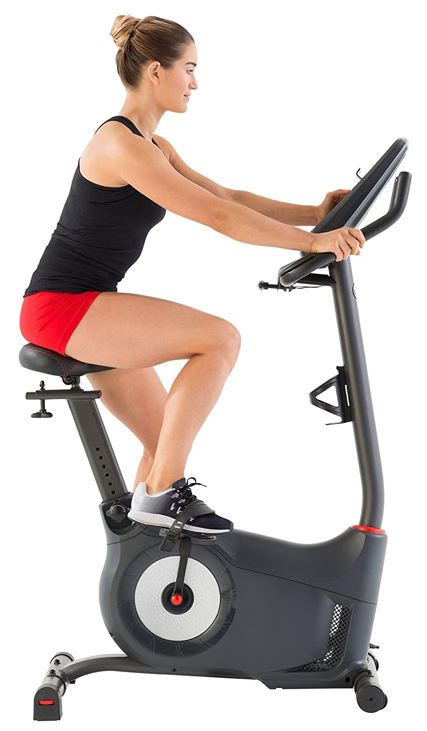 Woman riding Schwinn 170 Upright Bike