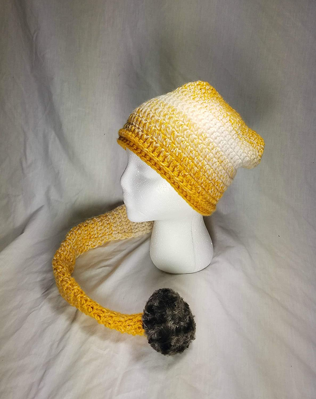 Crochet acrylic yarn hat with faux fur tassell