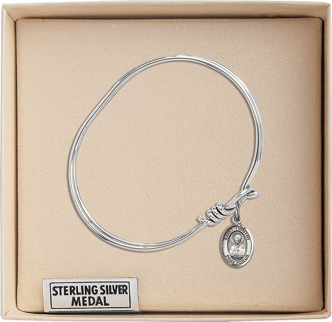 St Timothy Charm On A Child Sized 5 3//4 Inch Oval Eye Hook Bangle Bracelet