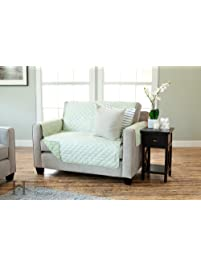 deluxe reversible quilted furniture protector beautiful print on one side solid color on the