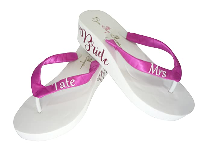 2026cc9443bd3 Image Unavailable. Image not available for. Color  Pink Mrs last name and  Bride Shimmer Lettering Flip Flops
