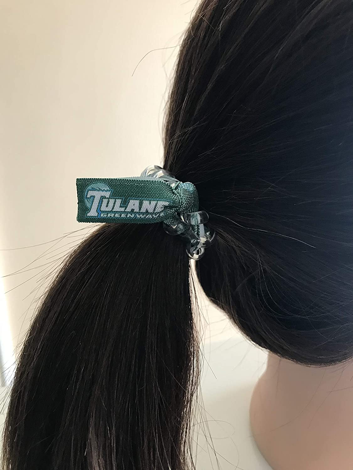 Amazon.com  Tulane Green Wave football secure sports hair tie hair cord hair  elastic for all pony tail types messy buns foe hair art  Handmade 882ab9657d0