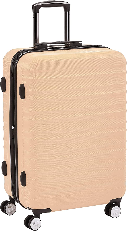 AmazonBasics - Maleta rígida giratoria prémium de 68 cm, rosa