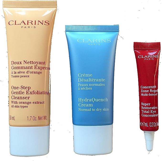 Clarins Estuche de regalo y bolsa de viaje (limpiador, crema hidratante y concentrador de ojos total súper reparador y bolsa) rojo: Amazon.es: Belleza