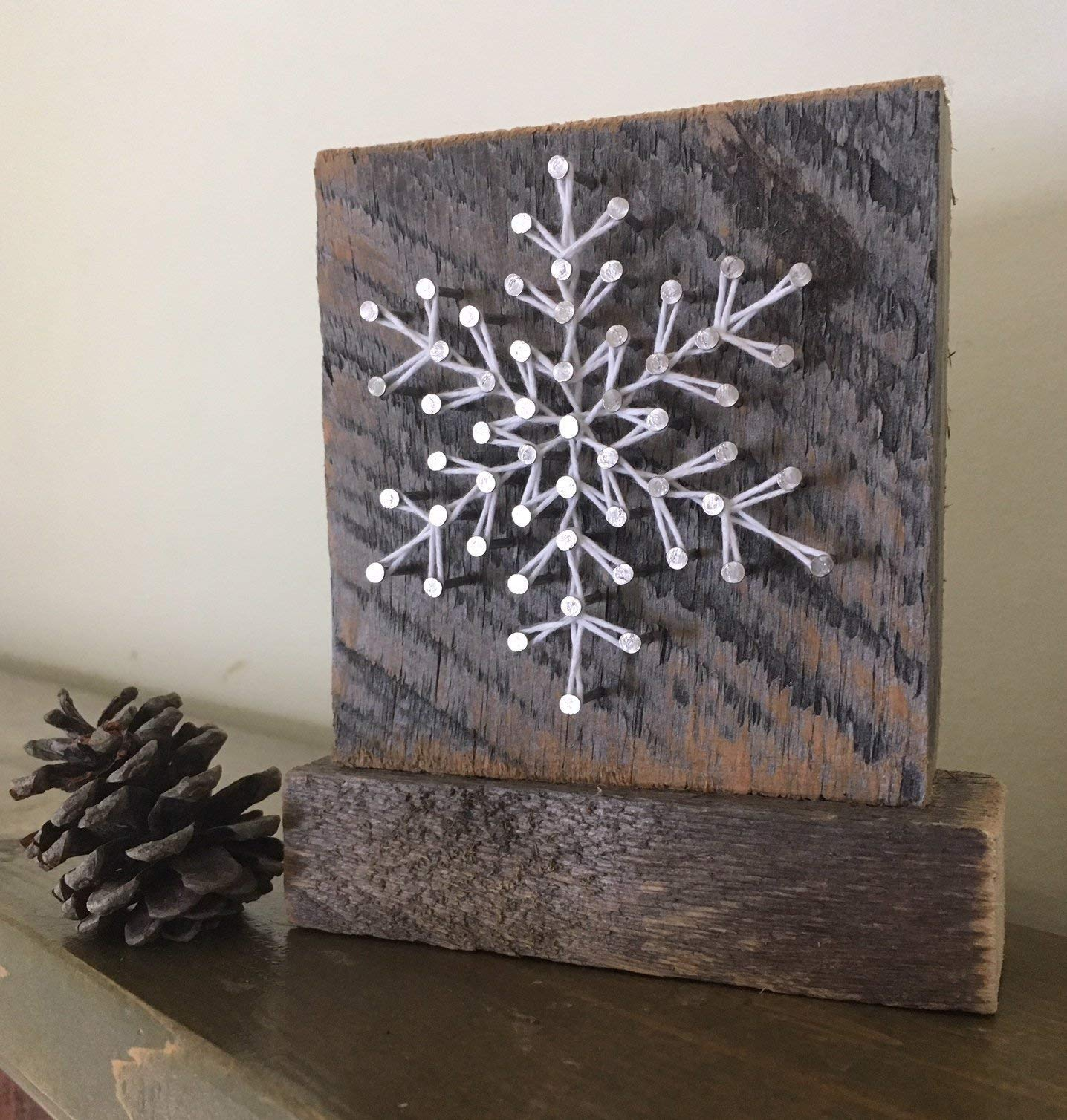 Sweet & Small freestanding wooden snowflake''frosty'' string art decor sign. Perfect for holiday home accents, ski cabins and and snowflake gifts for winter enthusiasts by Nail it Art. by Nail it Art (Image #1)