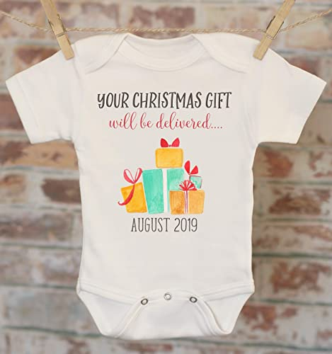 2d33e84760106 Amazon.com: Your Christmas Gift Will Be Delivered Pregnancy Reveal Onesie®,  Reveal to Grandparents, Pregnancy Announcement, Coming Soon Onesie: Handmade