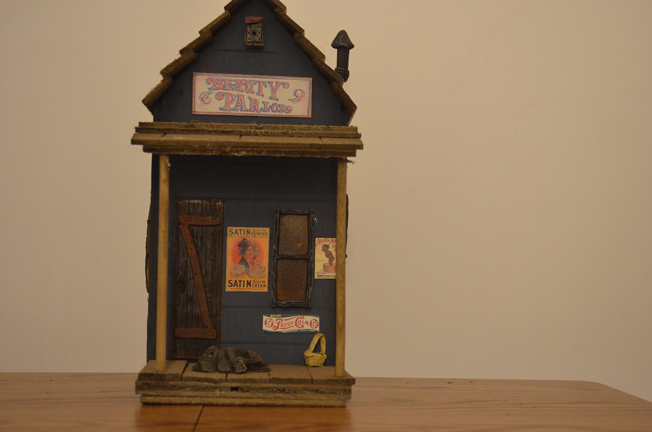 Birdhouse (With Entrance/ Exit Hole in the Front and Access Hole in the Back for Detachable Light to Glow Through the Windows and Doors) Resembling a Wooden Blue Beauty Parlor Decorated with Windows, a Door, a Dog, Basket, and Signs. Measurements Are 9 1/