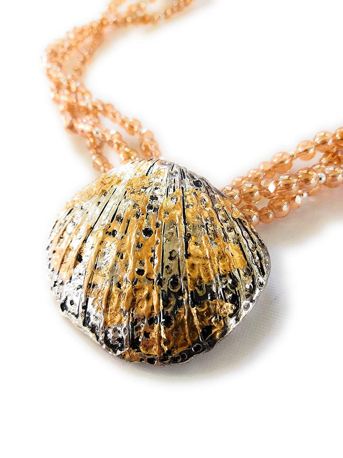 handmade silver and gold leaf shell pendant by Boot Jewelry Shop on Amazon