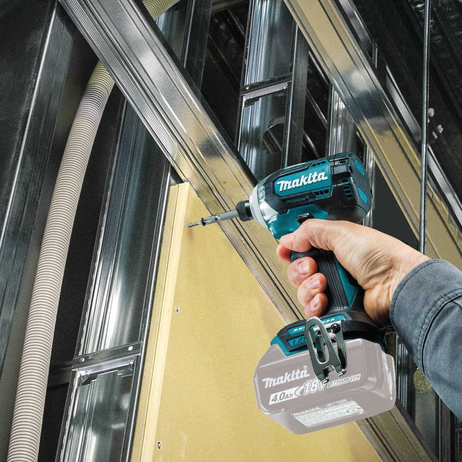 Image of Makita XDT12Z Cordless Impact Driver Tightening a screw