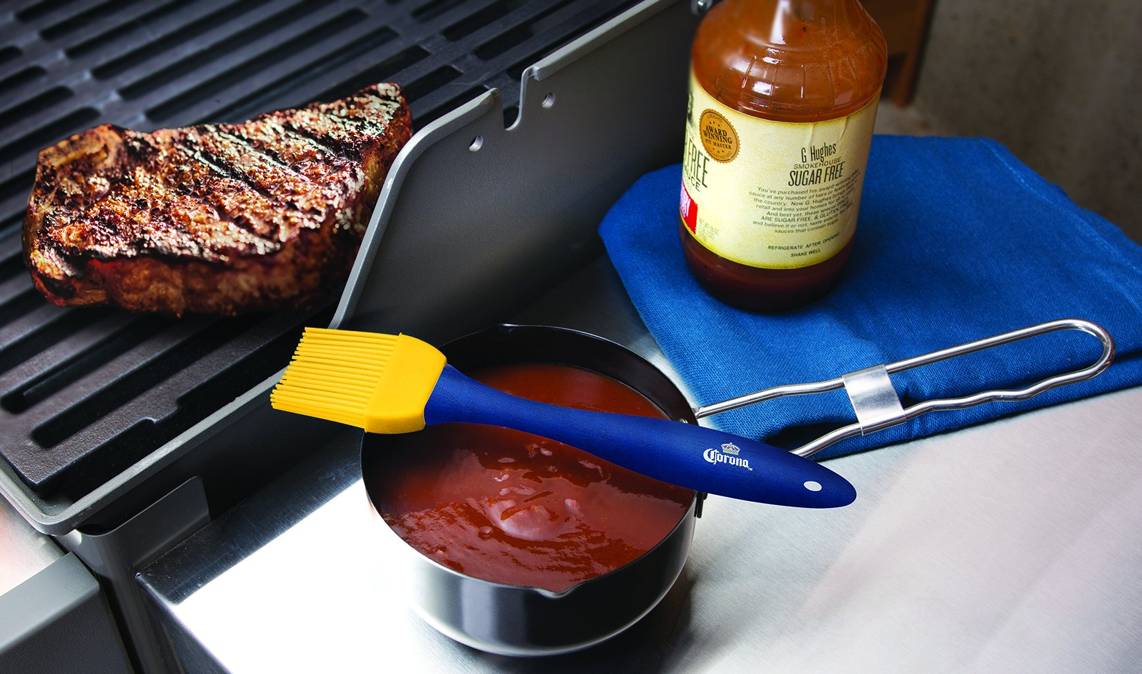 "Corona Basting Brush and Sauce Pot Set - 2 Piece BBQ Grilling Silicone Basting Brush And Steel Non-stick Sauce Pot Barbeque Accessory 2 TWO PIECE SET FOR OUTDOOR GRILLS - The premium silicone basting brush and sauce pot combo is ideal for use in the kitchen when cooking and baking or for outdoors when grilling and basting meats! Perfect for beef, chicken, seafood, vegetables and more. Brush measures 7.75"" in length. BPA FREE FOOD GRADE BRUSH - Baste in style with the cookout brushes ergonomic comfort grip handles. Use for for toast, jam, honey, pastry, condensed milk, breakfast, birthday party, picnics, outdoor BBQ brush for food. Durable heat resistant silicone bristles up to 400 degrees F. SAUCE POT FOR GLAZES AND MORE - The nonstick coated sauce pot is perfect for different sauces while cooking. DO NOT HEAT POT. Hand Wash Only. Sauce pot measures 4.5"" in diameter and is 2.5"" deep. Holds 18 ounces of liquid."