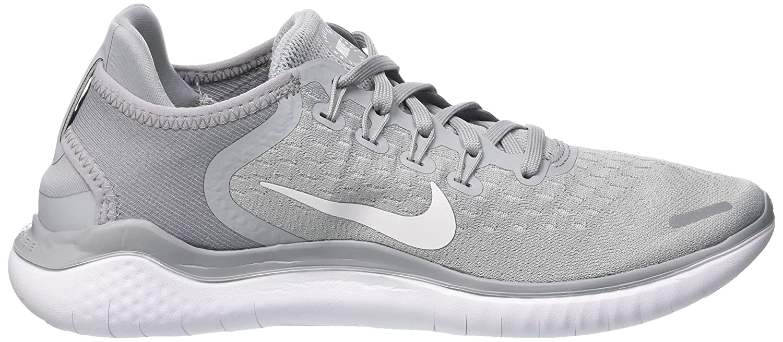 cd52de56028c Amazon.com  Nike Womens Free Run 2018 Running Shoes Wolf Grey White Volt  942837-003 Size 9.5  Sports   Outdoors