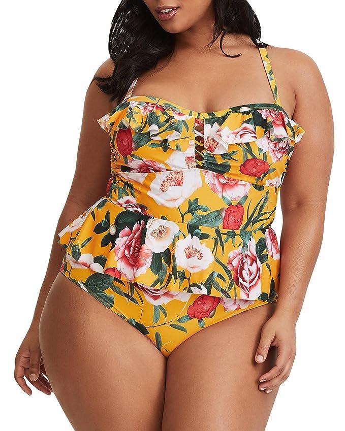 8b1d14b57 Traje de baño enterizo modelo vintage con estampado floral y volantes en el  área superior del busto y en la cintura. Disponible en tela amarilla y  negra.