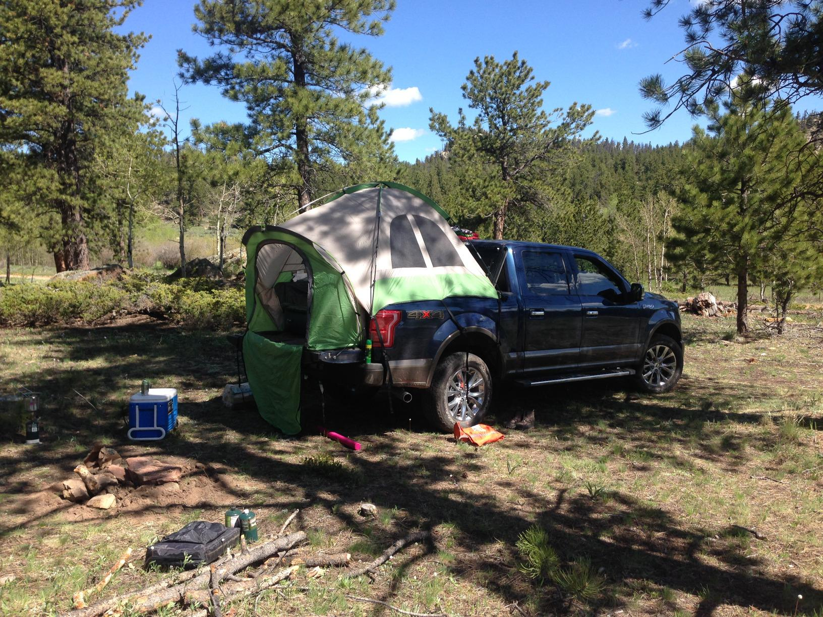 Tent set up just fine with the tonneau cover flipped up in place. Plenty of room, and more