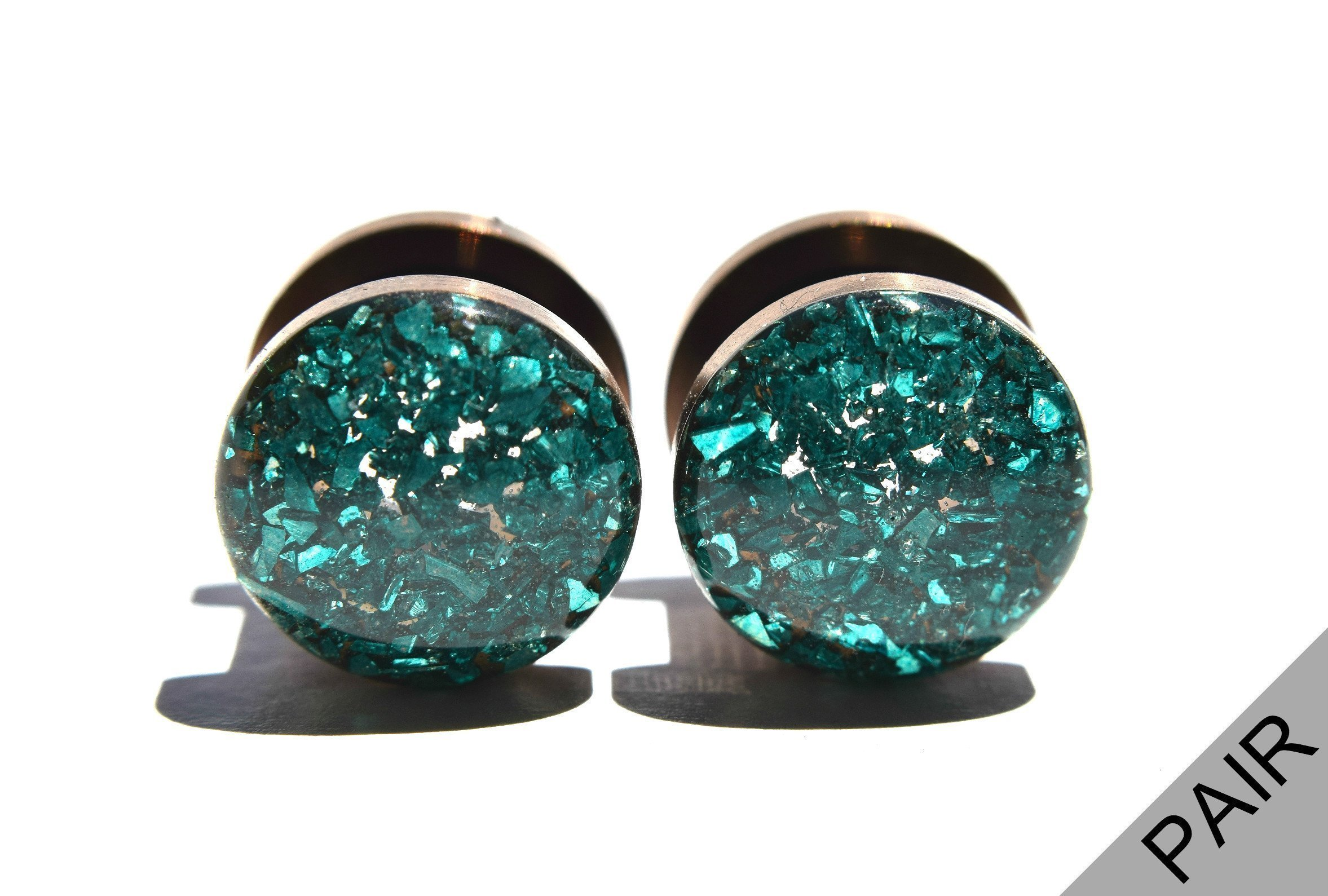 Handmade Emerald Green Crushed Glass shown on Bronze Plugs - 16g, 10g, 8g, 6g, 4g, 2g, 0g, 00g, 7/16in, 1/2in, 9/16in, 5/8in, 11/16in, 3/4in, 7/8in and 1 inch