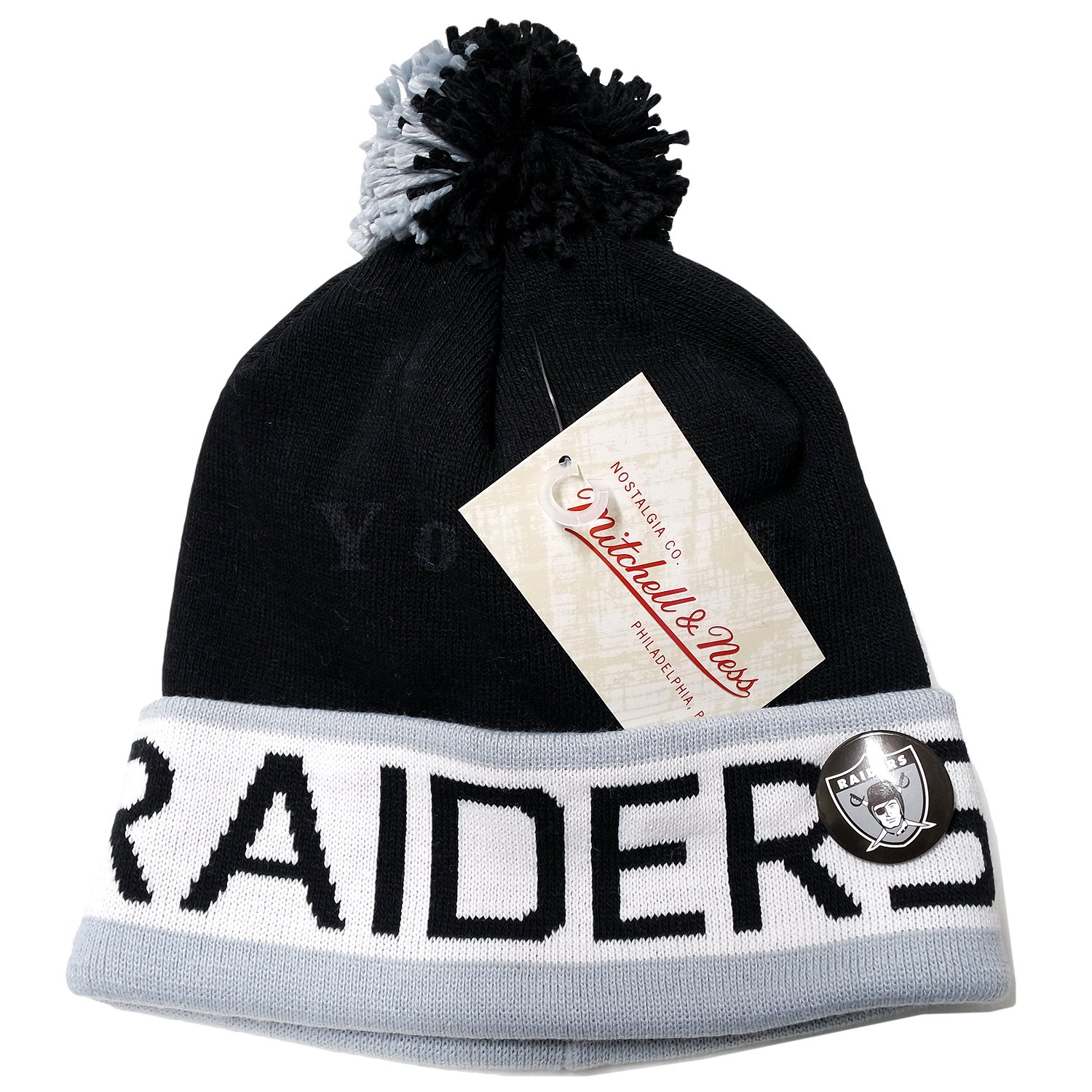 e194bcd07bc55 Amazon.com   Mitchell and Ness NFL Oakland Raiders 2 Tone Cuffed Knit Pom  Beanie Cap with Pin   Sports   Outdoors