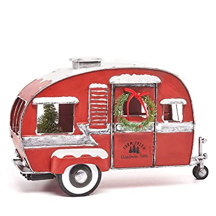 members mark red classic vintage holiday camper with white and colored lights indooroutdoor