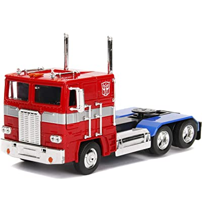 Transformers G1 Optimus Prime Truck with Robot on Chassis Die-cast Car: Toys & Games