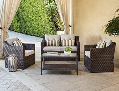 Solaura Outdoor Fully Woven 4-Piece Conversation Furniture Set All Weather Brown Wicker Beige Cushions Sophisticated Glass Coffee Table