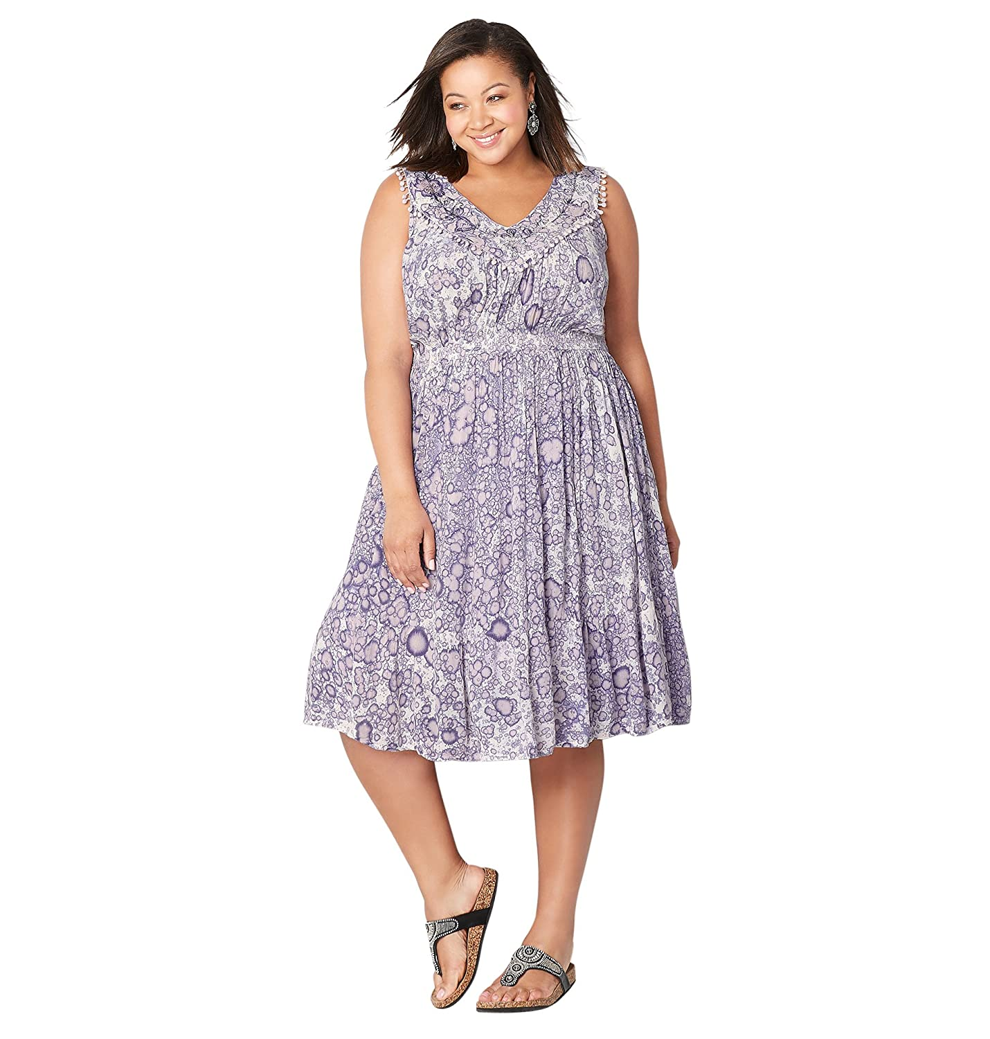 521f3406a3 Look beautiful in a dress with a unexpected splatter print allover.  Embroidered v-neckline is decorated with small pom pom trim giving this  dress a fun ...