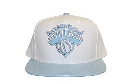 9cea2c73 Mitchell And Ness Men's New York Knicks NBA Powder Blue 2T Snapback Cap,  White at Amazon Men's Clothing store: