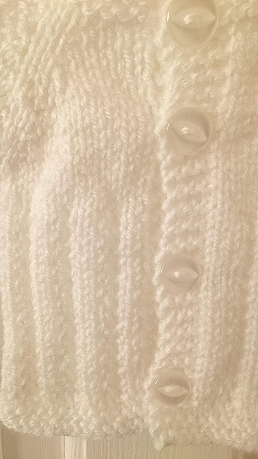 in white low birth weight baby or baby doll. in the tiniest of sizes precious preemie round neck long sleeved cardigan Harlow Will fit premature baby