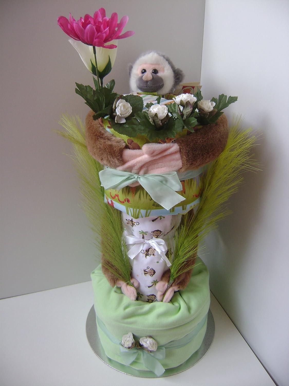 Unisex Luxus 2 Etagen Monkey Treehouse Windeltorte auf einem Bett aus mit Blumen und wunderschönen Dekoblättern
