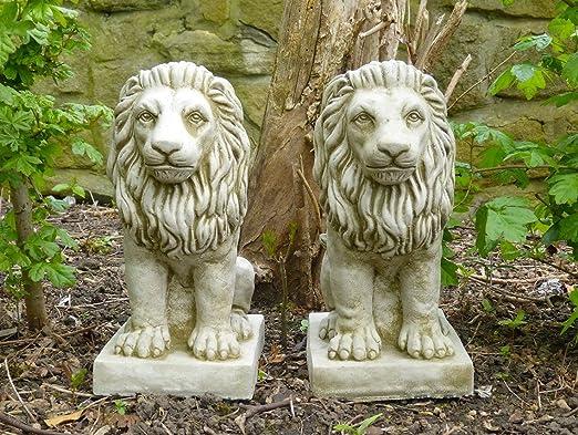 2 figuras decorativas para jardín, diseño de leones, tamaño pequeño, piedra: Amazon.es: Jardín