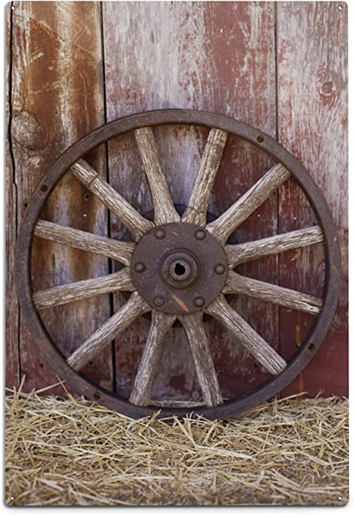 Wooden Wagon Wheel Wall Decor from images-na.ssl-images-amazon.com