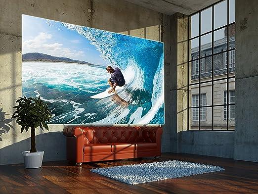 Papel pintado fotográfico que muestra un surfer en una ola - imagen mural de un surfer en una ola - decoración mural XXL by GREAT ART (210 x 140 cm): ...