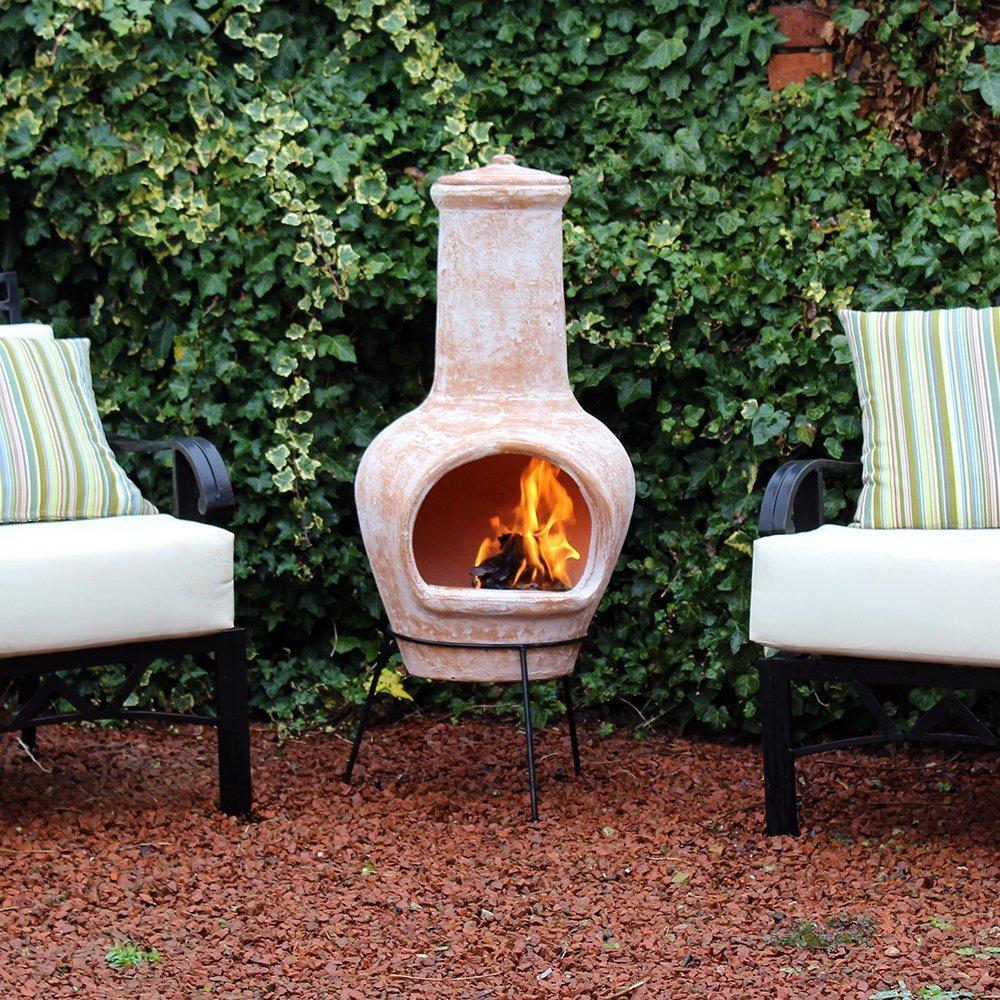 Grande terracota combustión de madera chimenea al aire libre ...