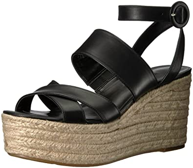 a11ebe048 Nine West Women's KUSHALA Leather Wedge Sandal, Black, 8 Medium US
