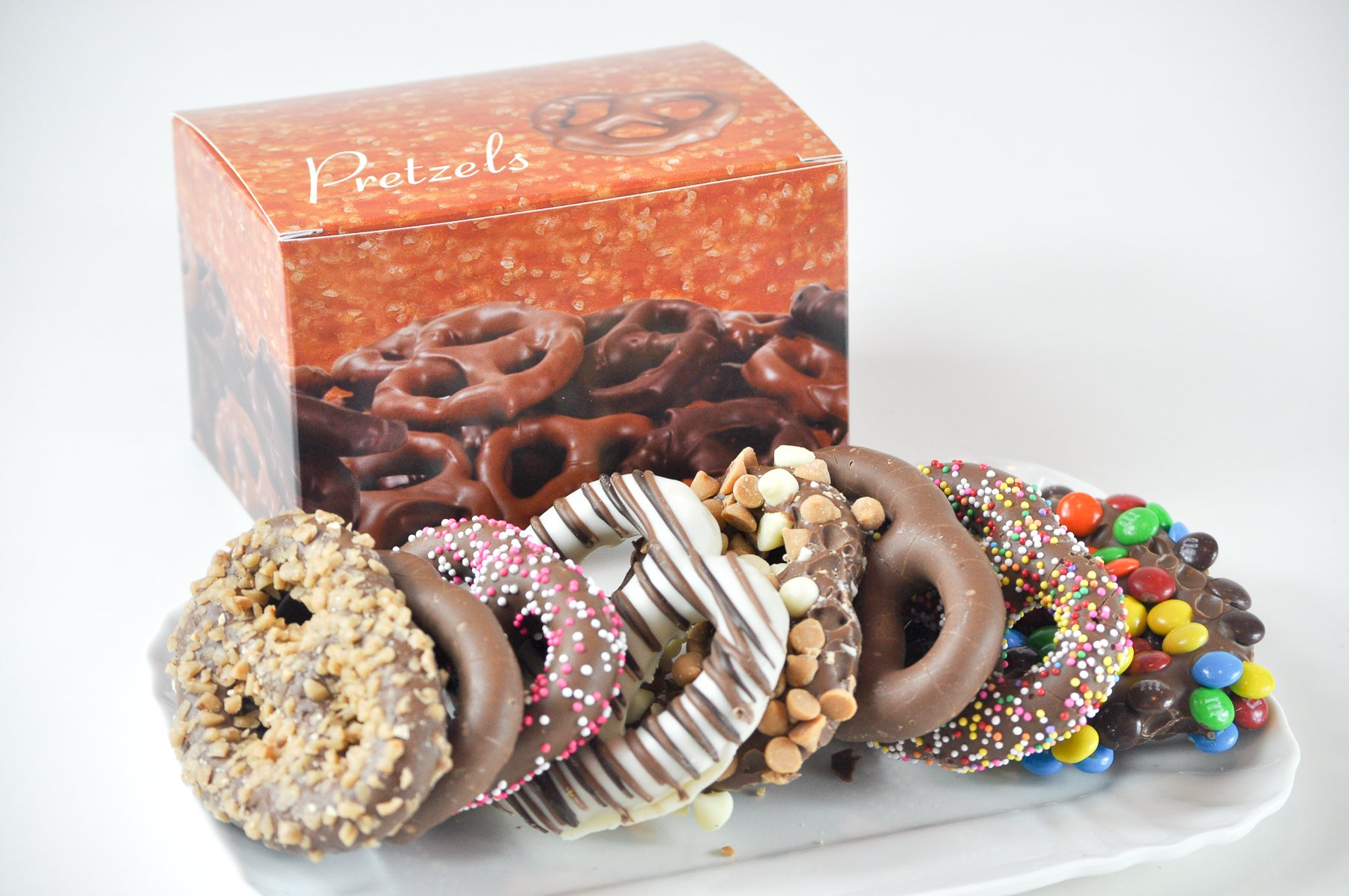 CHOCOLATE PRETZELS WITH TOPPINGS (ASSORTED) - 8 PC BOX