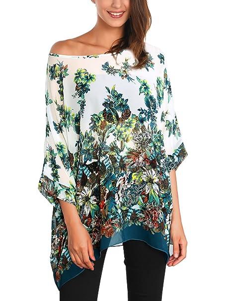 Bonita blusa holgada con motivos florales. Ligeramente transparente.