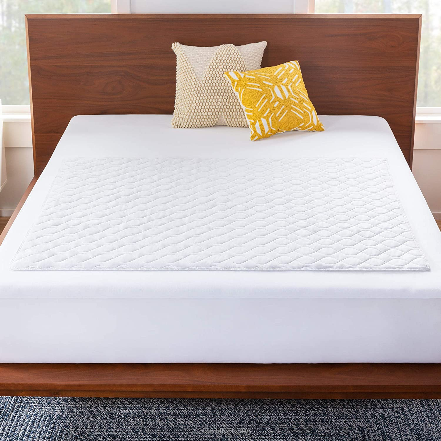 Amazon Com Linenspa 44 X 52 Skid Resistant Waterproof Sheet And Mattress Protector Pad Super Comfortable Quilted Finish Highly Absorbent For Bed Wetting Incontinence And Pets Machine Washable White Home Kitchen