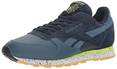 Reebok Men s CL Leather SM Fashion Sneaker Collegiate Navy Brave Blue Skll  Gry  a1319ca62