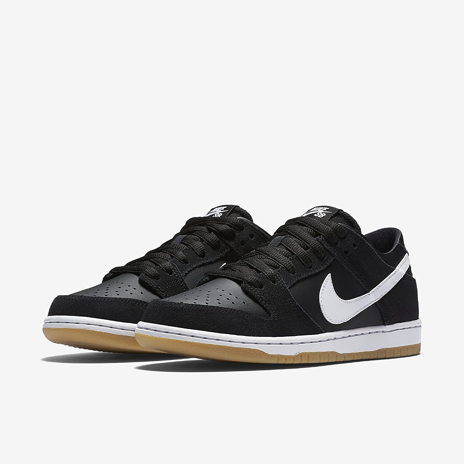 d3bc55549079 Amazon.com  NIKE Men s Sb Zoom Dunk Low Pro Black White Gum Light Brown  Skate Shoe (5.5)  Sports   Outdoors